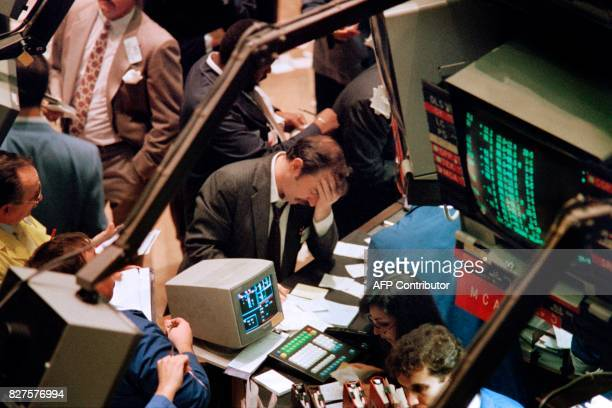 A trader on the New York Stock Exchange reacts on October 19 1987 as stocks are devastated during one of the most frantic days in the exchange's...