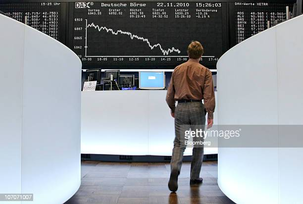 A trader passes the Dax index curve at the Frankfurt Stock Exchange in Frankfurt Germany on Monday Nov 22 2010 Stocks in Europe fell for a second day...