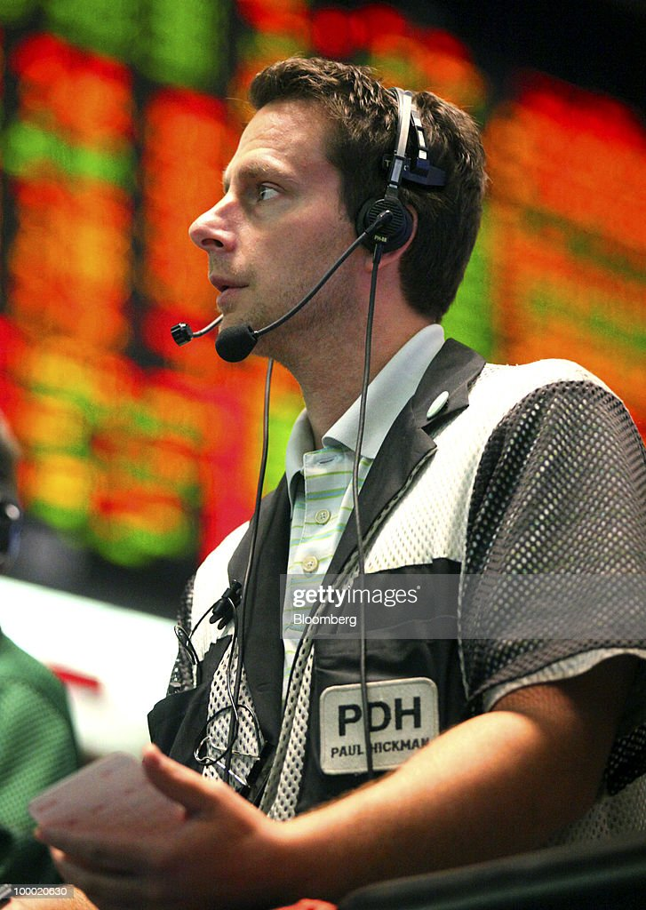 Trader Paul Hickman works in the Eurodollar options trading pit at CME Group Inc.'s Chicago Board of Trade in Chicago, Illinois, U.S., on Thursday, May 20, 2010. The euro declined against the dollar on concern European governments are divided on how to contain financial turmoil in the wake of the sovereign-debt crisis. Photographer: Tim Boyle/Bloomberg via Getty Images Paul Hickman