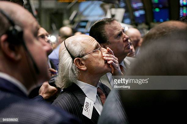 Trader Peter Tuchman center works on the New York Stock Exchange floor in New York US on Tuesday Feb 17 2009 US stocks tumbled to a threemonth low...