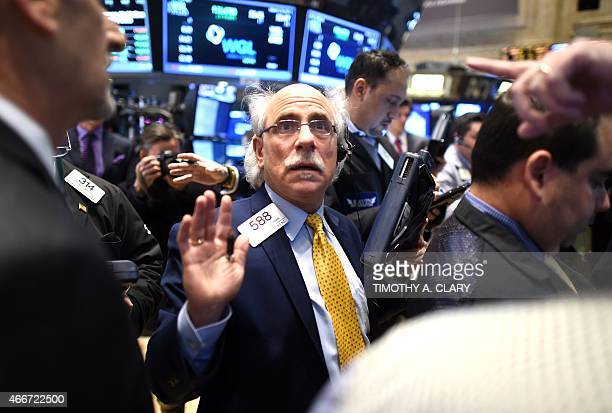 Trader Peter Tuchman on the floor of the New York Stock Exchange in New York March 18 2015 at the closing bell Wall Street stocks surged Wednesday...