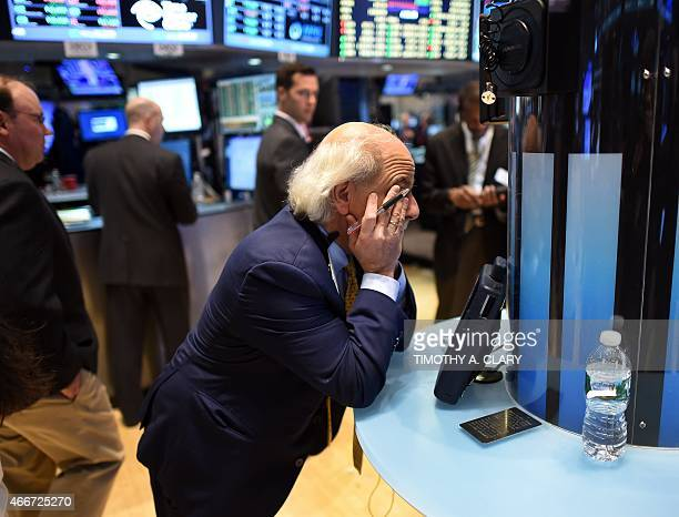 Trader Peter Tuchman takes a breather on the floor of the New York Stock Exchange in New York March 18 2015 at the closing bell Wall Street stocks...