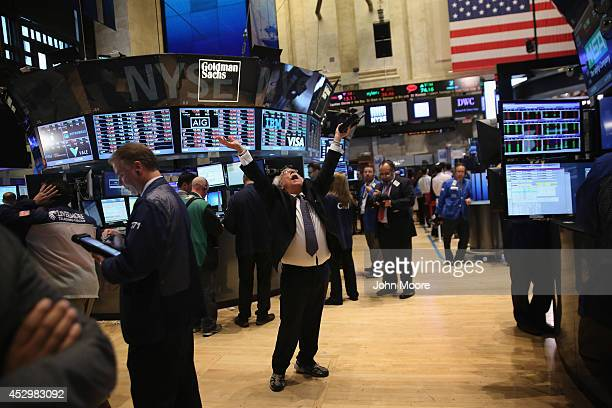 Trader Peter Tuchman throws his hands in the air at the closing bell of the New York Stock Exchange on July 31 2014 in New York City The Dow Jones...