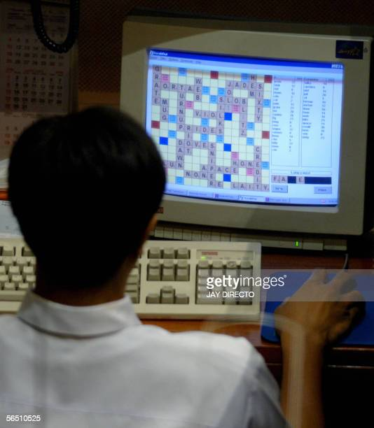 A trader plays scrabble on his computer at the Philippine Stock Exchange 02 January 2006 Share prices closed 019 percent lower on the first trading...
