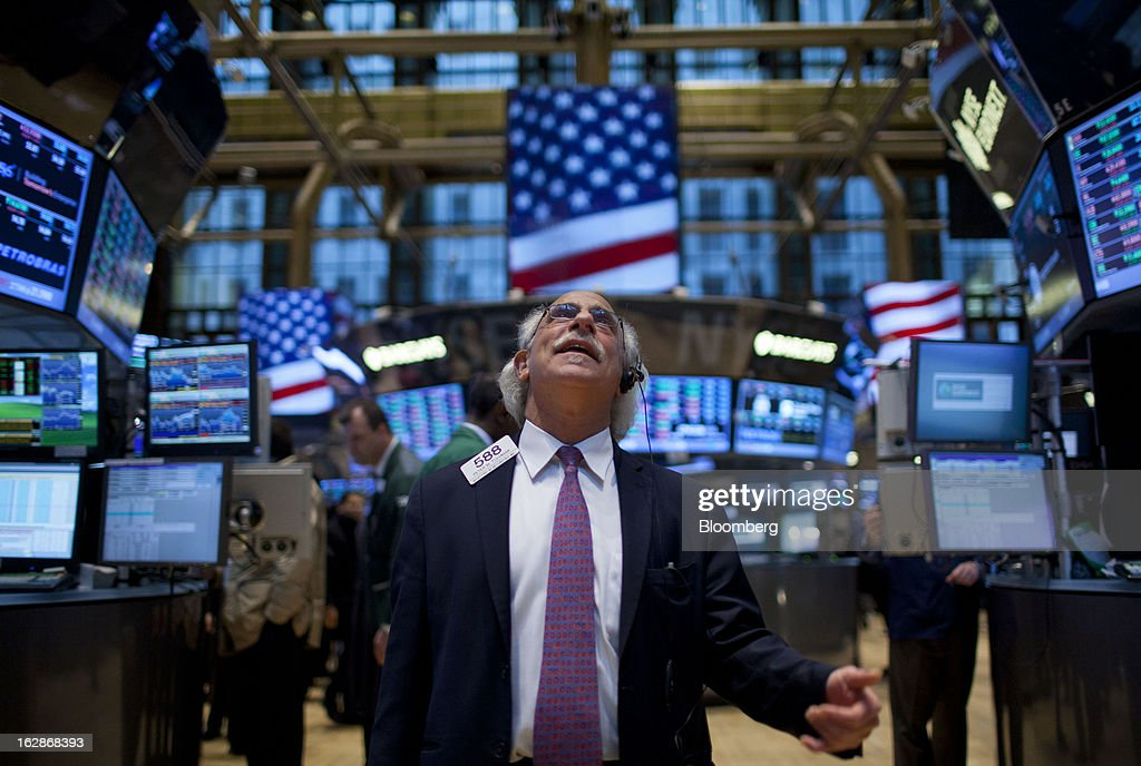 A trader reacts after the closing bell on the floor of the New York Stock Exchange (NYSE) in New York, U.S., on Thursday, Feb. 28, 2013. U.S. stocks erased gains in the final half hour of trading after the Senate rejected a pair of partisan proposals to replace $85 billion in automatic spending cuts scheduled to start tomorrow. Photographer: Jin Lee/Bloomberg via Getty Images