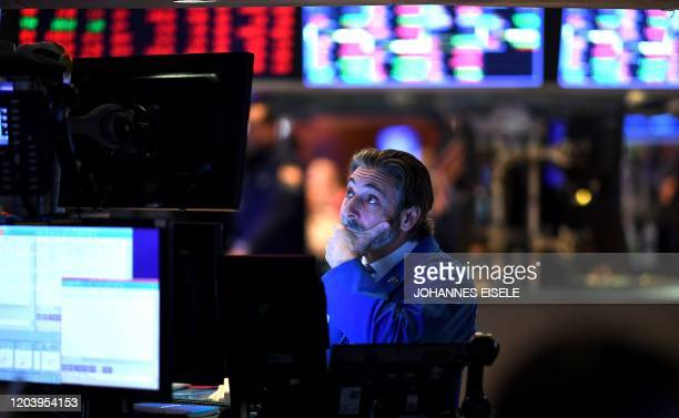 Trader reacts during the opening bell at the New York Stock Exchange on February 28, 2020 at Wall Street in New York City. - Losses on Wall Street...