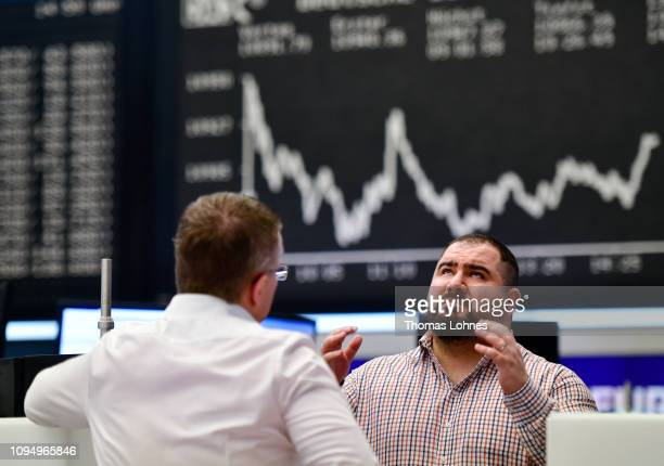 Trader reacts in front of the DAX index curve at the Frankfurt Stock Exchange the day after a large majority of MPs in the British House of Commons...