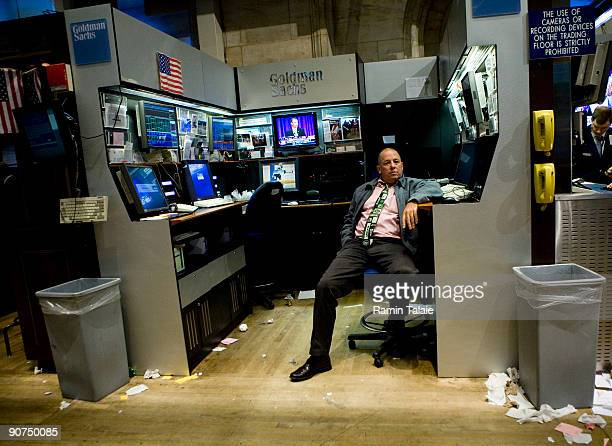 Trader relaxes on the floor of the New York Stock Exchange after the end of trading day on September 14, 2009 in New York City. President Obama gave...