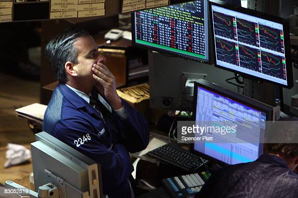 Trader rubs his face as he works on the floor of the New York Stock Exchange September 29, 2008 in New York City. U.S. Stocks took a nosedive in...
