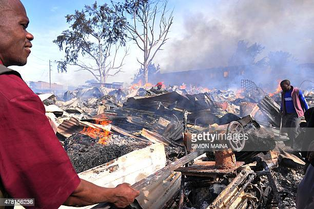 A trader salvages a sewing machine from the fire that engulfed a section of Gikomba market East Africa's largest second hand clothing market in...