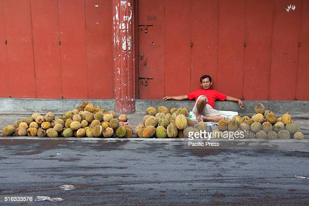 SELATPANJANG RIAU INDONESIA A trader selling durian in front of the court on a highway in Selat Panjang Riau