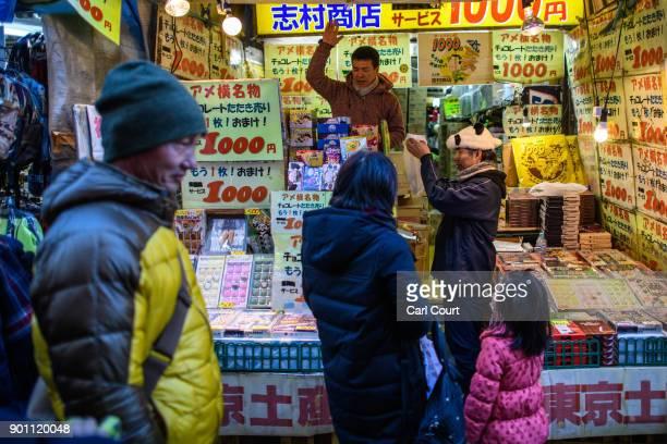 A trader sells discount chocolate on a stall in Ameya Yokocho market on January 4 2018 in Tokyo Japan Ameya Yokocho claimed to be Tokyo's last...