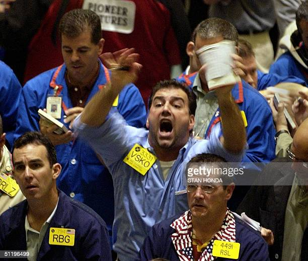 A trader shouts for attention in the crude oil futures pit 20 August on the floor of the New York Mercantile Exchange World oil prices hit new...
