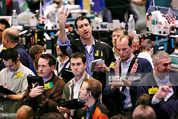 A trader signals a trade in the crude oil options pit at the New York Mercantile Exchange in New York US on Wednesday Dec 26 2007 Crude oil rose...