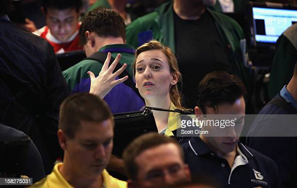 Trader signals an offer in the Standard & Poor's 500 stock index options pit at the Chicago Board Options Exchange following the Federal Open Market...