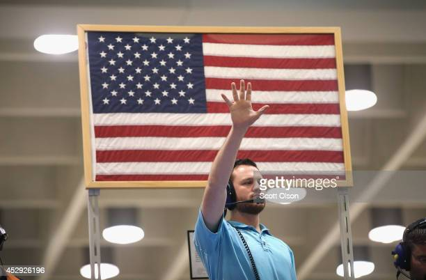 A trader signals an offer in the Standard Poor's 500 stock index options pit at the Chicago Board Options Exchange on July 30 2014 in Chicago...