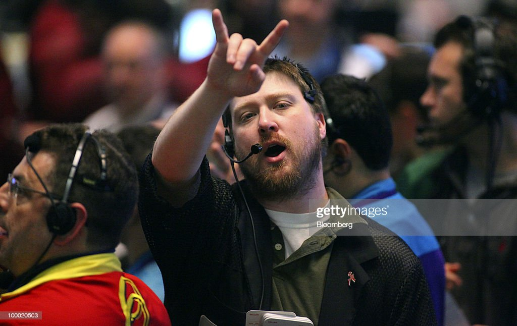 A trader signals an order in the Eurodollar options trading pit at CME Group Inc.'s Chicago Board of Trade in Chicago, Illinois, U.S., on Thursday, May 20, 2010. The euro declined against the dollar on concern European governments are divided on how to contain financial turmoil in the wake of the sovereign-debt crisis. Photographer: Tim Boyle/Bloomberg via Getty Images