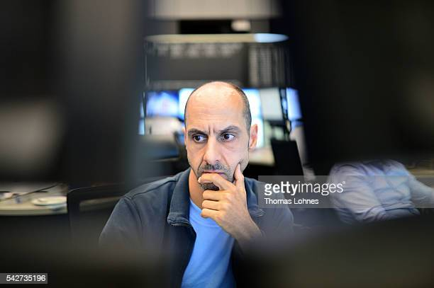 A trader sits at his desk at the Frankfurt Stock exchange the day after a majority of the British public voted for leaving the European Union on June...