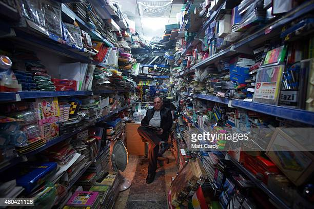 Trader sits inside stationary shop in the Qaysari Bazaar on December 13, 2014 in Erbil, Iraq. As insecurity continues throughout Iraq it was...