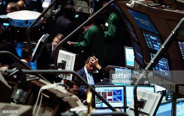 A trader stands on the floor of the New York Stock Exchange near the beginning of the trading day October 17 2008 in New York Markets continued their...