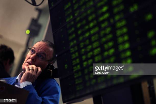 Trader takes an order in the Standard & Poor's 500 stock index options pit at the Chicago Board Options Exchange following the Federal Open Market...