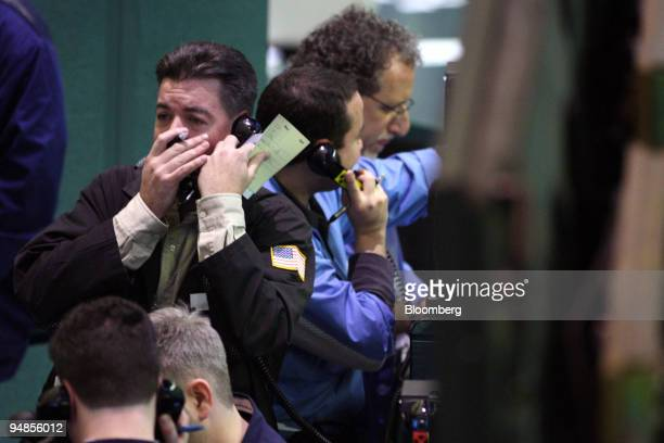 A trader talks on a phone while working near the crude oil options pit at the New York Mercantile Exchange in New York US on Thursday March 20 2008...