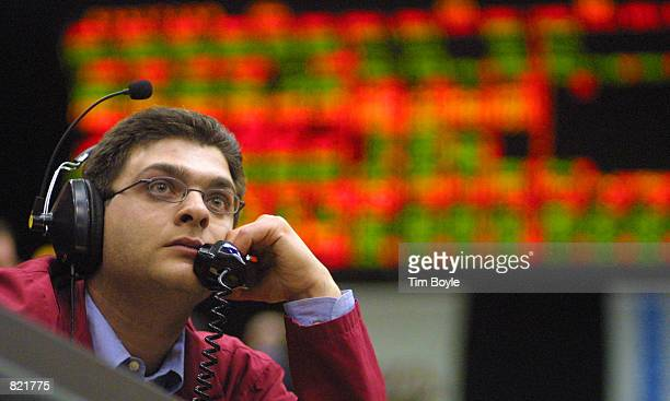 A trader talks on a telephone as he awaits interest rate information in the Eurodollar Futures pit of the Chicago Mercantile Exchange March 20 2001...