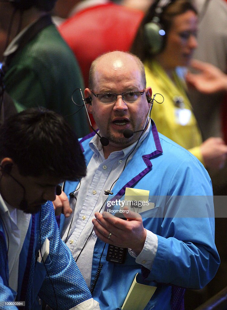 A trader talks on his headset while working in the Eurodollar options trading pit at CME Group Inc.'s Chicago Board of Trade in Chicago, Illinois, U.S., on Thursday, May 20, 2010. The euro declined against the dollar on concern European governments are divided on how to contain financial turmoil in the wake of the sovereign-debt crisis. Photographer: Tim Boyle/Bloomberg via Getty Images