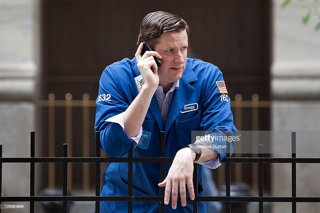 A trader talks on his phone outside the New York Stock Exchange in New York on July 29, 2011 in New York City. Bankers and economists were invited to meet with Treasury Department officials at the Federal Reserve Bank of New York today to discuss the on-going debt-limit crisis and how it could effect markets.