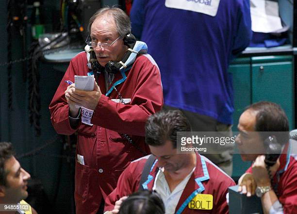 A trader talks on the phone while working near the crude oil futures pit on the floor at the New York Mercantile Exchange in New York US on Tuesday...