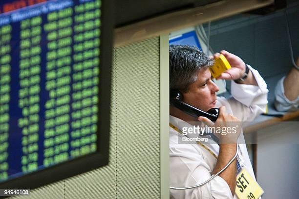 A trader talks on the phone while working on the floor at the Bolsa de Mercadorias e Futuros or Brazilian Mercantile and Futures Exchange in Sao...