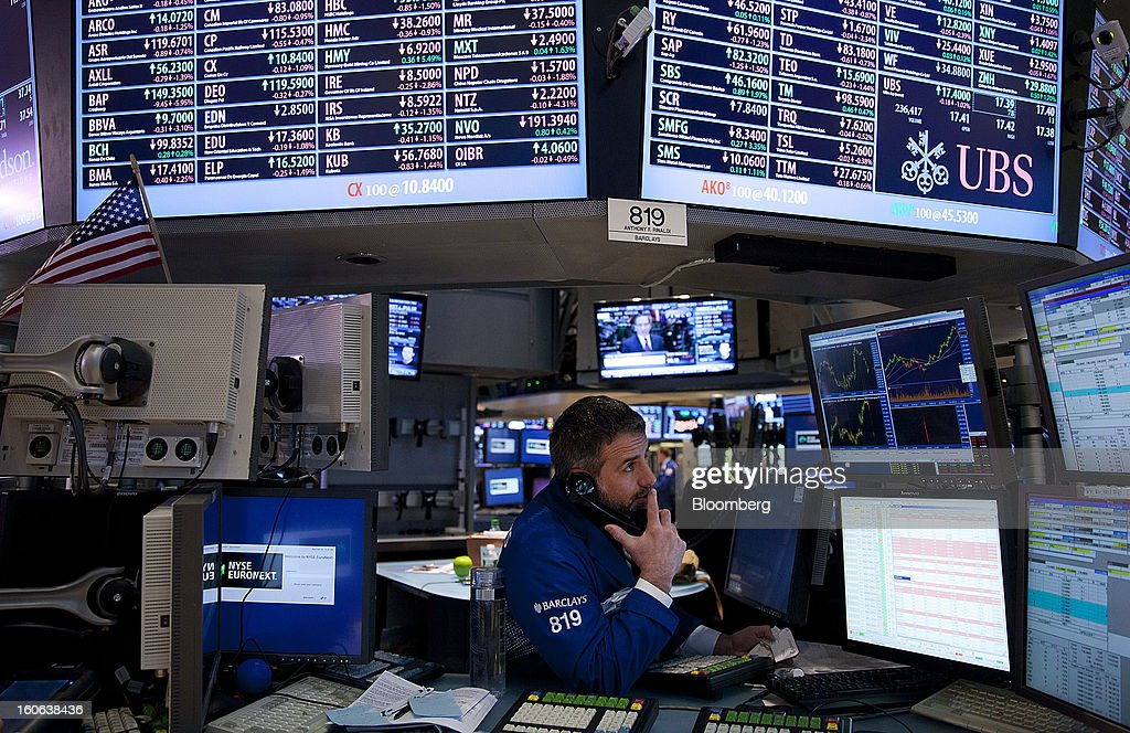 A trader talks on the phone while working on the floor of the New York Stock Exchange (NYSE) in New York, U.S., on Monday, Feb. 4, 2013. U.S. stocks fell, after the Standard & Poor's 500 Index jumped to a five-year high, on concern over increasing political tension in Europe as investors awaited data on factory orders. Photographer: Jin Lee/Bloomberg via Getty Images