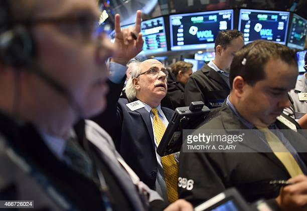 Trader trader Peter Tuchman on the floor of the New York Stock Exchange March 18 2015 at the closing bell Wall Street stocks surged Wednesday after...