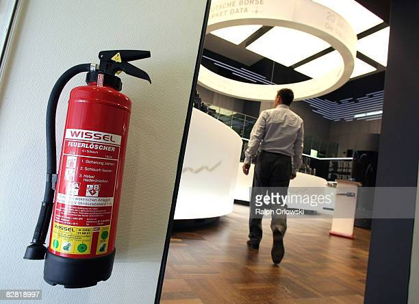 A trader walks across the trading floor at Frankfurt stock exchange on September 15 2008 in Frankfurt Germany Due to collapse of US fourth largest...
