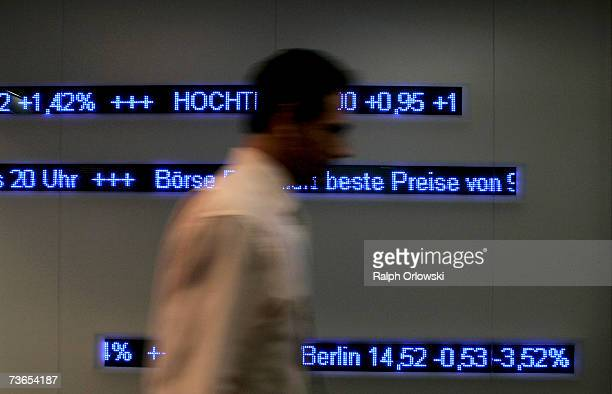 A trader walks across the trading floor of Frankfurt stock exchange on March 21 2007 in Frankfurt Germany The German Stock Exchange has changed its...