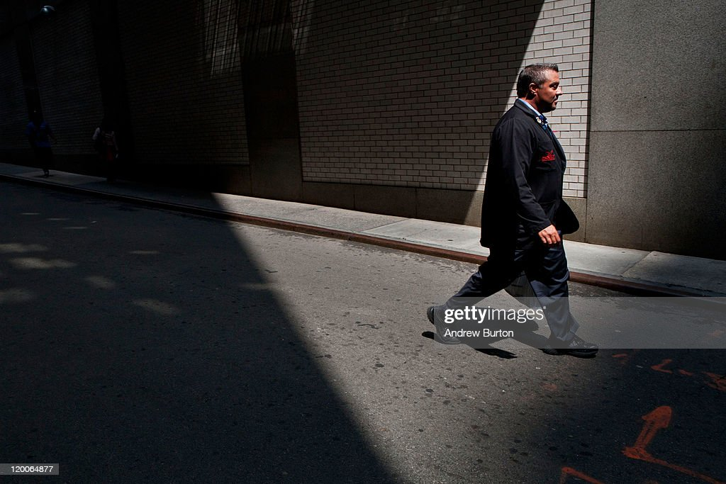 A trader walks outside the New York Stock Exchange on July 29, 2011 in New York City. Bankers and economists were invited to meet with Treasury Department officials at the Federal Reserve Bank of New York today to discuss the on-going debt-limit crisis and how it could effect markets.