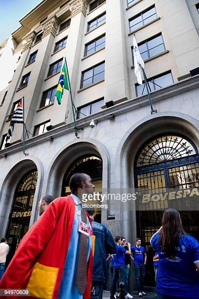 F trader walks past the Bolsa De Valores De Sao Paulo or Sao Paulo Stock Exchange building in Sao Paulo Brazil on Thursday May 21 2009 Brazilian...