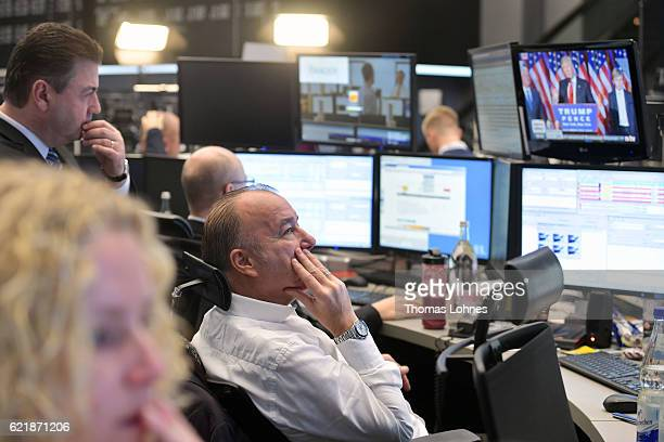 Trader watch the speech of Donald Trump after he wins the US presidential elections at the Frankfurt Stock Exchange on November 9 2016 in Frankfurt...