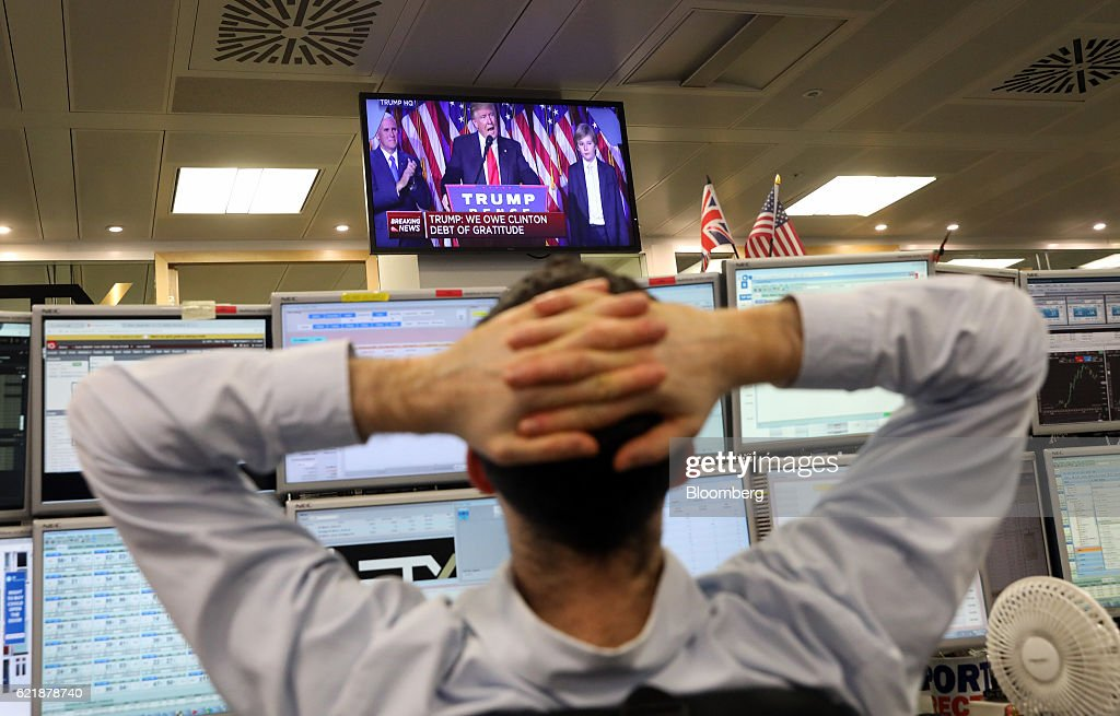 ETX Capital Traders Watch Market Reaction After U.S. Presidential Election : News Photo