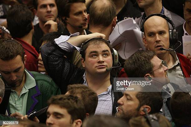 Trader watches offers in the Eurodollar options pit at the Chicago Mercantile Exchange following the announcement from the Federal Open Market...