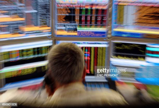 A Trader watches screens on August 18 2011 in Paris in an office of the French investment company Aurel BGC World stock markets tumble on lingering...