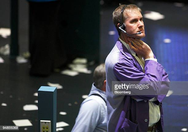 A trader watches the trading board while working in the crude oil futures pit on the floor at the New York Mercantile Exchange in New York US on...