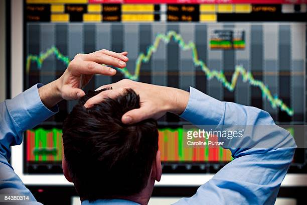 Trader watching stocks crash on screen