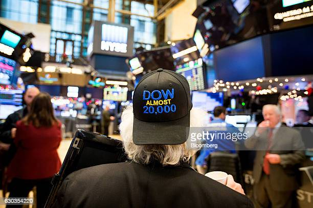 A trader wearing a 'DOW ALMOST 20000' hat works on the floor of the New York Stock Exchange in New York US on Wednesday Dec 21 2016 US stocks...
