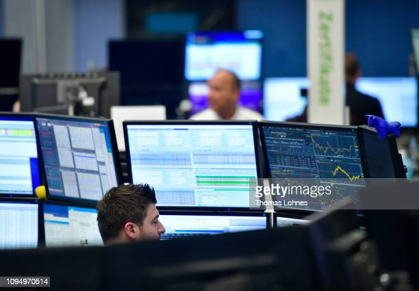 Trader work at the Frankfurt Stock Exchange the day after a large majority of MPs in the British House of Commons rejected British Prime Minister...