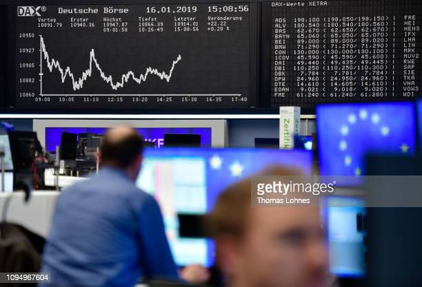 Trader work in front of the DAX index curve at the Frankfurt Stock Exchange the day after a large majority of MPs in the British House of Commons...