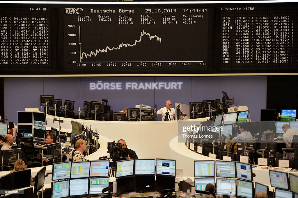 Trader work under the the day's performance board of the DAX stock market index not long after the DAX broke the 9,000 level at the Frankfurt Stock Exchange on October 25, 2013 in Frankfurt, Germany. Today's level sets a new record for the DAX, which is the main German stock market index.