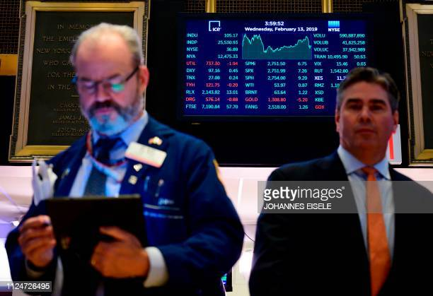 A trader works ahead of the closing bell on the floor of the New York Stock Exchange February 13 2019 in New York City Wall Street stocks rose for a...