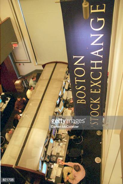 A trader works at his computer March 20 2001 at the Boston Stock Exchange in Boston MA Stocks rallied yesterday on investors'' hopes that Federal...