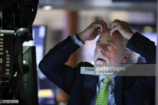 A trader works at his desk during the closing bell on the floor of the New York Stock Exchange on November 20 2018 in New York City Markets dipped...